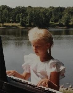 young Rachel playing piano
